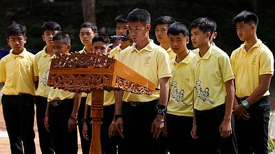 A year later, Thailand's rescued 'cave boys' honour diver who died