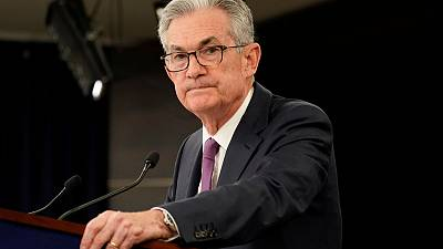 Powell says Fed is wrestling with whether to cut rates, insulated from politics