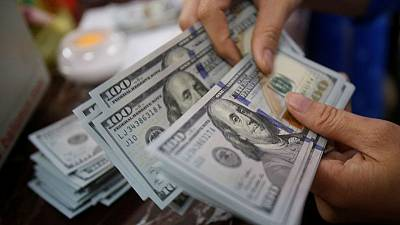 Dollar gains on lower rate cut expectations, stocks flat