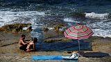 School closures, frozen bananas and faith: Europeans struggle with heatwave