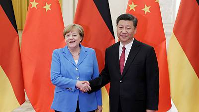 China's Xi, Germany's Merkel agree Iran issue should be resolved peacefully - Xinhua