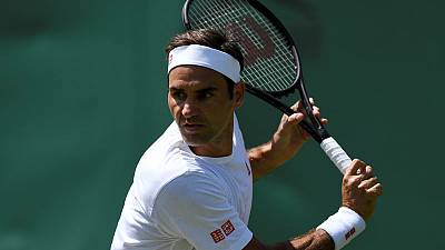 Federer opposes on-court coaching