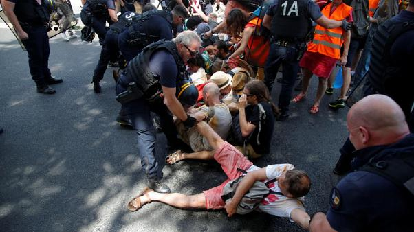 French police probed over rough break-up of climate demo
