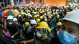 Hong Kong police fire tear gas in running battles after protesters trash legislature