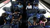 Mexico buses home migrants who gave up on U.S. asylum claims