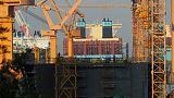 South Korea cuts growth views as trade war batters exports