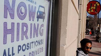 U.S. job growth accelerates; wages rise moderately