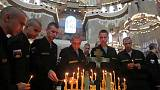 Putin bestows top state honours on sailors killed in submarine fire
