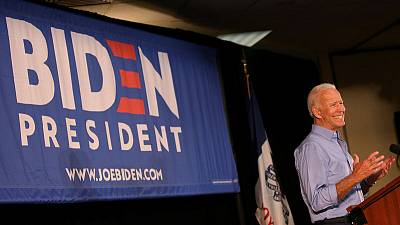 Democratic candidates court black voters; Biden addresses race criticism