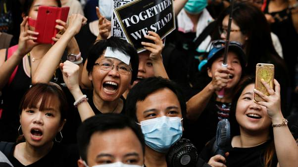 Hong Kong protesters march again, reaching out to Chinese visitors