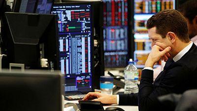 UK stocks slip as Fed rate cut hopes fade, IAG falls on fine