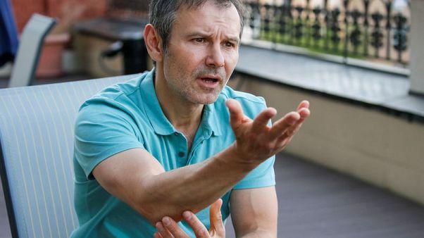 Rock star seeks to upstage comedian president in Ukraine vote