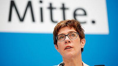 ECB should mull curbing low interest period - Merkel heir apparent