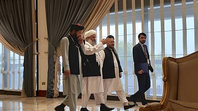 Afghans, Taliban talk in Qatar about peace as war rages at home