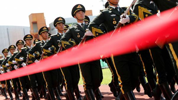 Exclusive: China's PLA signals it will keep Hong Kong-based troops in barracks