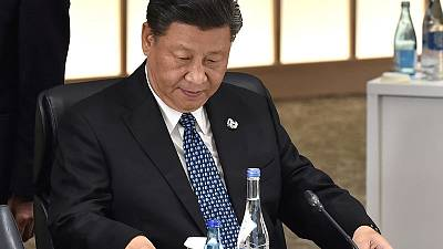 China's Xi tells officials not to be lazy and 'spend whole day eating'
