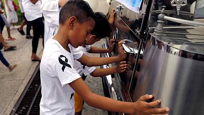 Calls for justice, intervention as Philippines buries drug war's youngest known victim