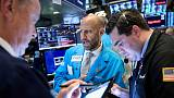 Global stocks climb, dollar drops as Fed chair remarks boost rate-cut hopes