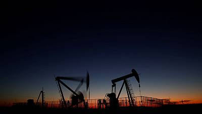 Oil rises more than 1% after U.S. stockpile drop; Brent nears $65