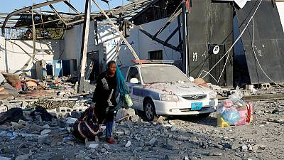 Bombed Tripoli migrant detention centre being emptied - U.N.