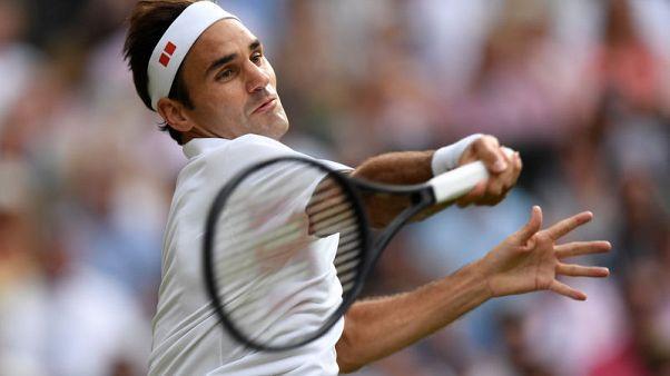 Federer overcomes shaky start to join Gram Slam 100 club