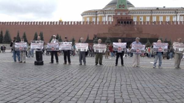 Russian police detain Crimean Tatar protesters on Moscow's Red Square