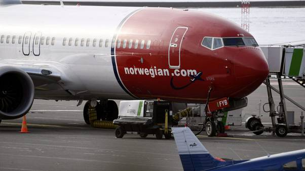 Norwegian Air sees Boeing 737 MAX flying again in October as second quarter beats