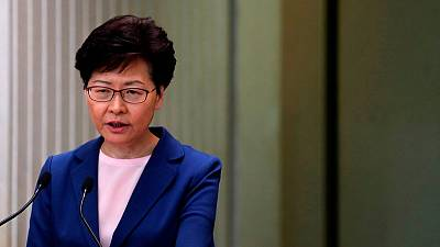 China's top official in Hong Kong says Beijing backs city's leader