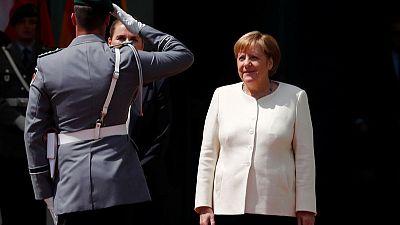 Merkel says German coalition discord over EU top job 'is not easy'