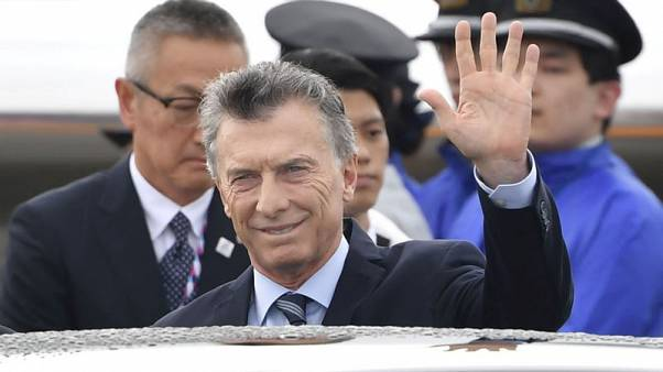 Argentine President Macri picked in poll to narrowly win re-election