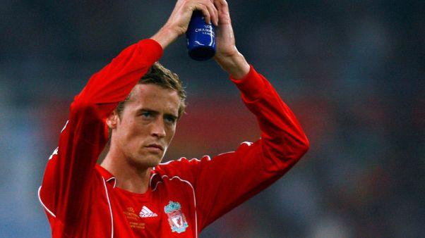Former England striker Crouch announces retirement