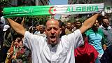 Algerian protesters push for reforms, man tries to burn himself