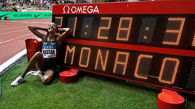 Hassan breaks women's mile world record on emotional night