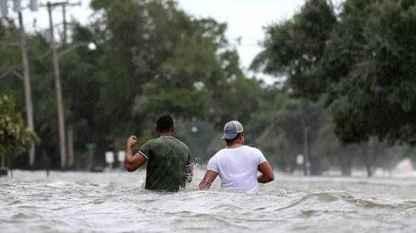 Barry drenches Louisiana after weakening to tropical storm