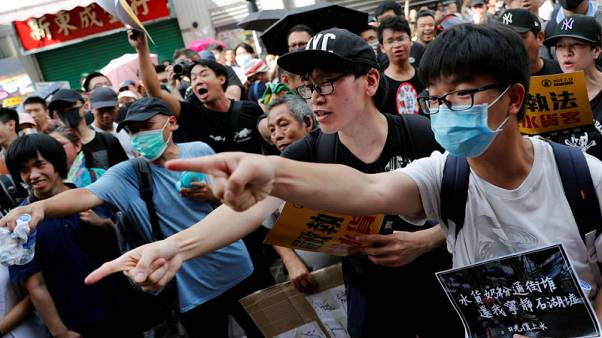 Hong Kong protesters, police clash as demonstrations target Chinese traders
