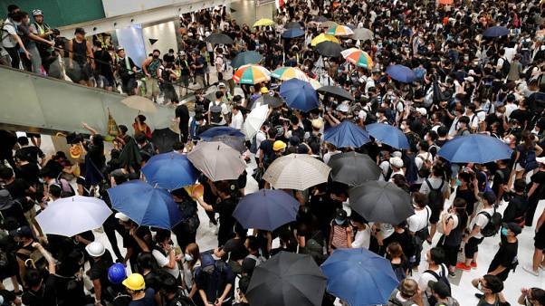 Clashes break out as Hong Kong protesters escalate fight in suburbs