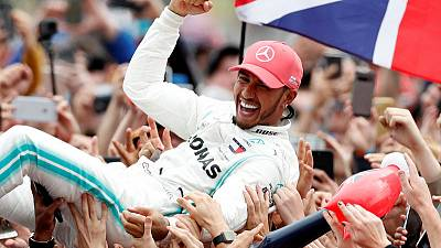 Hamilton flies the flag with pride in record British GP win