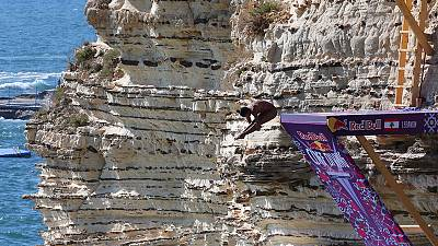 Cliff divers leap from Beirut landmark in international tour