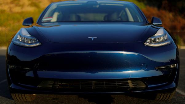 Tesla cuts price of mass-marked Model 3, lifts prices of premium EVs