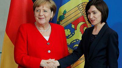 Merkel says new German defence minister will quickly succeed von der Leyen