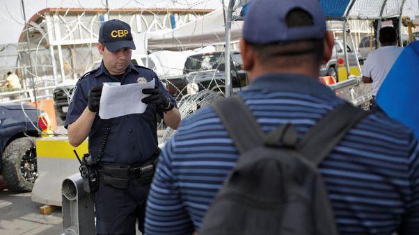 Asylum seekers anxiously cross into U.S. as new policy kicks in