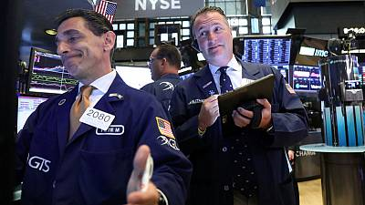 Stocks fall on trade, earnings caution; oil drops