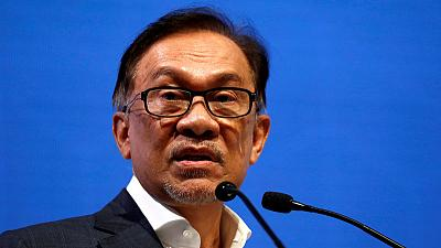 "Malaysia's Anwar says he has support to become PM, decries sex tape ""gutter politics"""