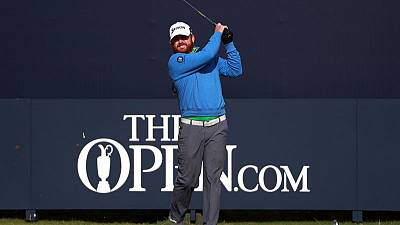 Holmes sets pace as McIlroy cards nightmare 79 at Open