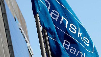 Danske Bank second quarter pre-tax profit hit by costs, low interest rates