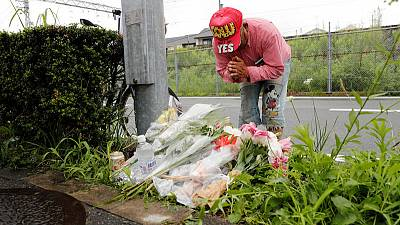 Animation fans lay flowers, pay respects at Japan studio ravaged by arson
