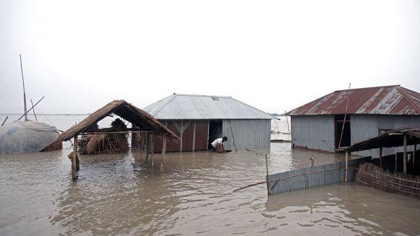 Bangladesh floods worsen after breach, death toll nears 100 in India