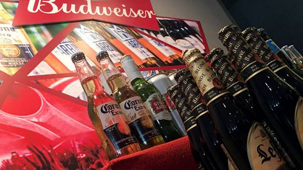 Debt-laden AB InBev agrees sale of Australian unit to Asahi