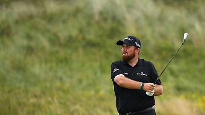 Holmes consolidates lead, Lowry on the charge