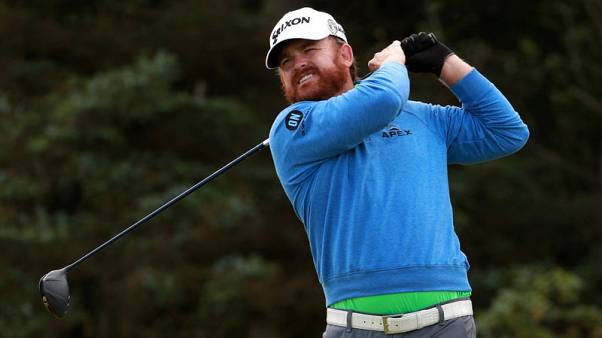 Holmes and Lowry share lead as Fleetwood and Westwood push